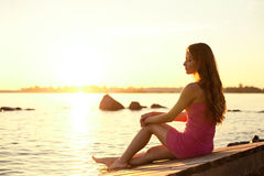 Beauty woman on the beach at sunset. Enjoy nature. Luxury girl r Stock Photo