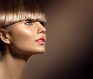 Beauty woman with beautiful makeup and healthy brown hair Stock Image