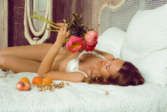 Beauty woman in bed in white interior Royalty Free Stock Images