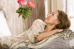 Beauty woman in bed in white interior Royalty Free Stock Photo