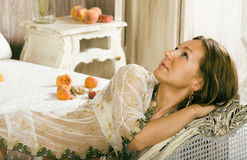Beauty woman in bed in white interior Stock Photos