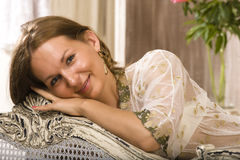 Beauty woman in bed in white interior Stock Photography