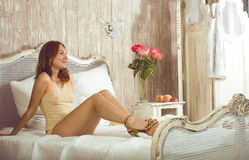 Beauty woman in bed in white interior Royalty Free Stock Photography