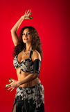 Beauty woman belly dance with finger cymbals. Beauty woman in belly dance with finger cymbals Stock Images