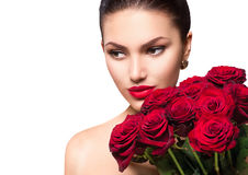 Beauty woman with big bouquet of red roses royalty free stock photography