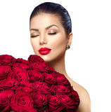 Beauty woman with big bouquet of red roses Royalty Free Stock Photo