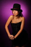 Beauty woman in black corset and silk hat Royalty Free Stock Photos