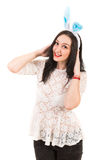 Beauty woman with blue bunny ears. On her head isolated on white background Stock Images