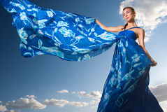 Beauty woman in blue dress on the desert Stock Photos