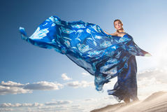 Beauty woman in blue dress on the desert Royalty Free Stock Image