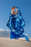 Beauty woman in blue dress on the desert Stock Images