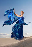 Beauty woman in blue dress on the desert Stock Photography