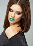 Beauty woman with blue lips, streight hair. Royalty Free Stock Photo