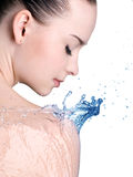 Beauty woman and blue water Stock Images