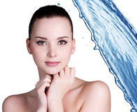 Beauty woman and blue water Royalty Free Stock Images