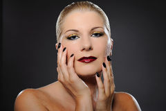 Beauty woman with bright make-up and dark manicure Royalty Free Stock Image