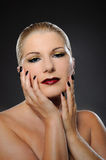 Beauty woman with bright make-up and dark manicure Stock Images