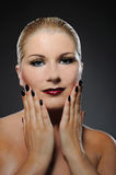 Beauty woman with bright make-up and dark manicure Royalty Free Stock Photos