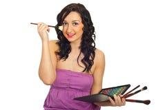 Beauty woman brushing face Stock Image