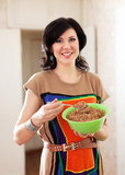 Beauty woman with buckwheat cereal Stock Images