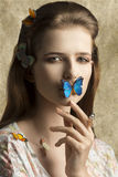 Beauty woman with butterfly Royalty Free Stock Photos