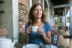 Beauty woman in cafe Stock Image