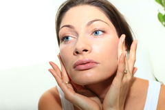 Beauty woman care. Woman make face massage by her self stock photos