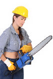 Beauty woman with chainsaw. On white background stock photo