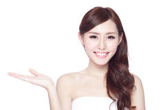 Beauty woman with charming smile. Beauty woman show something to you with charming smile, health skin, teeth and hair isolated on white background, asian beauty Royalty Free Stock Image