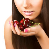 Beauty woman with  cherries on white Royalty Free Stock Photos