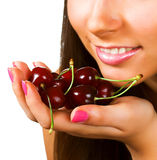 Woman with cherries on white Stock Photography