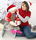 Beauty woman and child  at christmas decoration Royalty Free Stock Photos