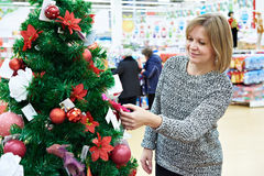 Beauty Woman Choose Toys For Christmas Tree Royalty Free Stock Images