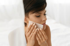 Beauty Woman Cleaning Beautiful Fresh Skin With Absorbing Tissue. Beauty. Woman Cleaning Perfect Fresh Skin With Oil Absorbing Tissue, Sheets. Closeup Portrait stock image