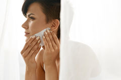 Beauty Woman Cleaning Beautiful Fresh Skin With Absorbing Tissue. Beauty. Woman Cleaning Perfect Fresh Skin With Oil Absorbing Tissue, Sheets. Closeup Portrait stock photos