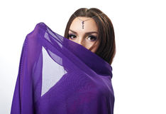 Beauty woman close face by purple cloth Royalty Free Stock Images