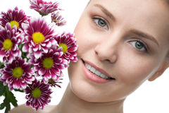 Beauty woman close-up face with flower Stock Photo