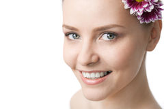 Beauty woman close-up face with flower royalty free stock photography