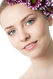 Beauty woman close-up face with flower Royalty Free Stock Photo