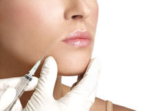 Beauty woman close up injecting cosmetic treatment. On white royalty free stock photo