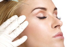 Beauty woman close up injecting cosmetic treatment. On white stock image