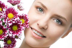 Beauty woman closeup face with flowers Royalty Free Stock Photography