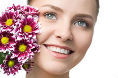 Beauty woman closeup portrait with flower Royalty Free Stock Images