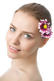 Beauty woman closeup portrait with flower Stock Photo
