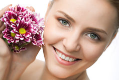 Beauty woman closeup portrait with flower Stock Photography