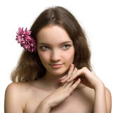 Beauty woman closeup portrait with flower isolated Royalty Free Stock Image