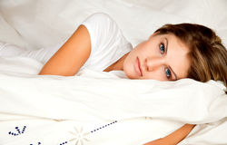 Beauty woman couch in the bed. Young beauty woman couch in the bed Royalty Free Stock Photo