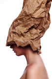 Beauty Woman with craft Paper on Head Stock Photos