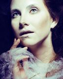 Beauty woman with creative make up like cocoon, scary halloween. Celebration Stock Image