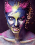 Beauty woman with creative make up like Holy celebration in India. Close up Stock Image